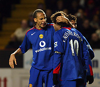 Photo: Chris Ratcliffe.<br />Charlton Athletic v Manchester United. The Barclays Premiership. 19/11/2005.<br />Rio Ferdinand (L) congratulates Ruud Van Nistlerooy on scoring his second goal