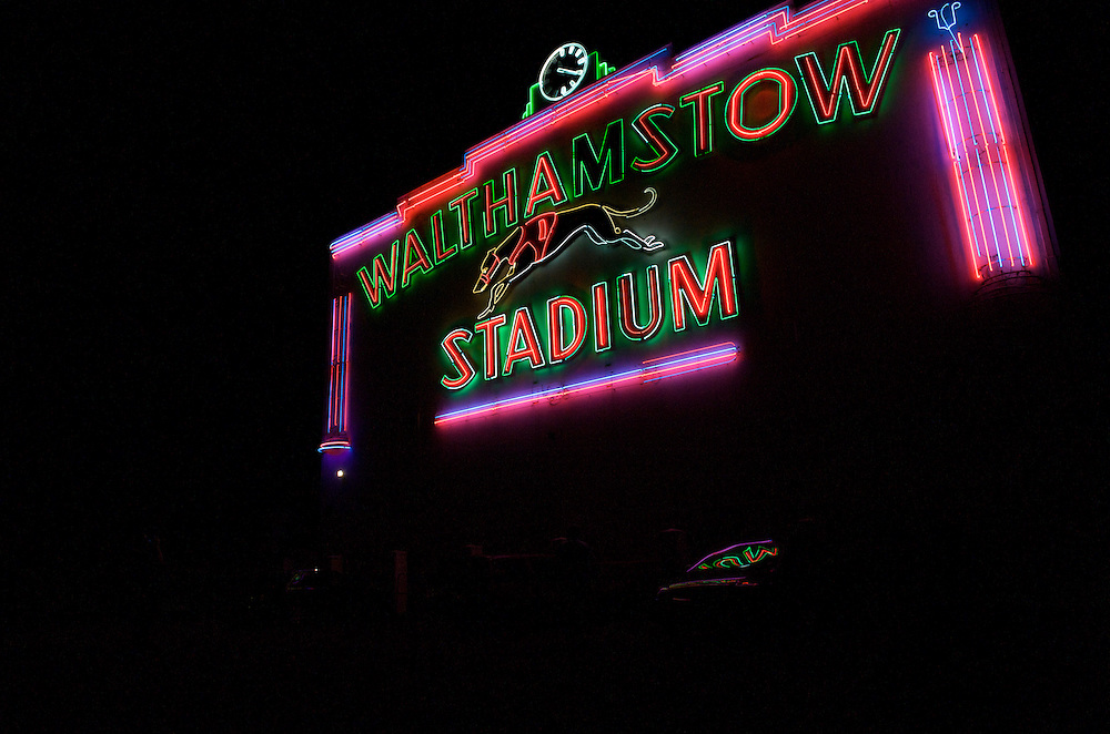 Walthamstow, England.  August 16, 2008.  The famous neon sign at Walthamstow Stadium flickers after the last night of racing in its 75 year history.  Forced to close as a result of diminishing profits and poor attendance, record crowds flocked to take in the festivites one last time...