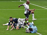 Football - 2020 / 2021 Sky Bet Championship - Swansea City vs Birmingham City - Liberty Stadium<br /> <br /> André Ayew of Swansea City leaps over Bartosz Bialkowski of Millwall in a goal mouth scramble