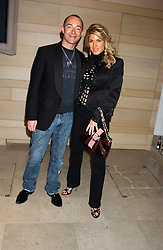 Designer SCOTT HENSHALL and HOFIT GOLAN at a cocktail party hosted by MAC cosmetics to kick off London Fashion Week at The Hospital, 22 Endell Street London on 18th September 2005.At the event, top model Linda Evangelista presented Ken Livingston the Lord Mayor of London with a cheque for £100,000 in aid of the Loomba Trust that aims to privide education to orphaned children through a natural disaster or through HIV/AIDS.<br />