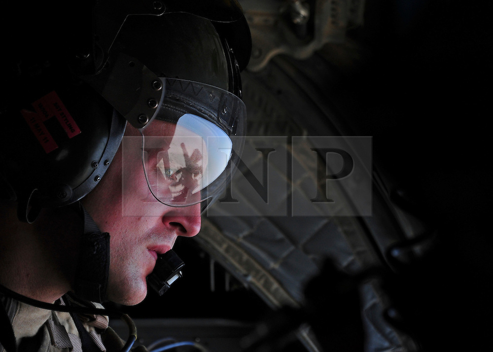 © London News Pictures. 11/06/11. AFGHANISTAN. Sgt Alex Stayling is a part of the RAF Aircrew team that man the chinook.  As he prepares the helicopter to land he checks the area to ensure that the landing site is safe from enemy fire. The RAF Regiment's Medical Emergency Response Team (MERT) is made up of two teams based in 'Main Operating Base Bastion', they are responsible for extracting casualties from anywhere within Helmand Province.  The MERT consists of a doctor, an emergency department nurse and two paramedics.  In addition four Royal Air Force Regiment gunners provide armed protection when they land and leave the helicopter to collect the casualty.   Caption must read Alison Baskerville/LNP...