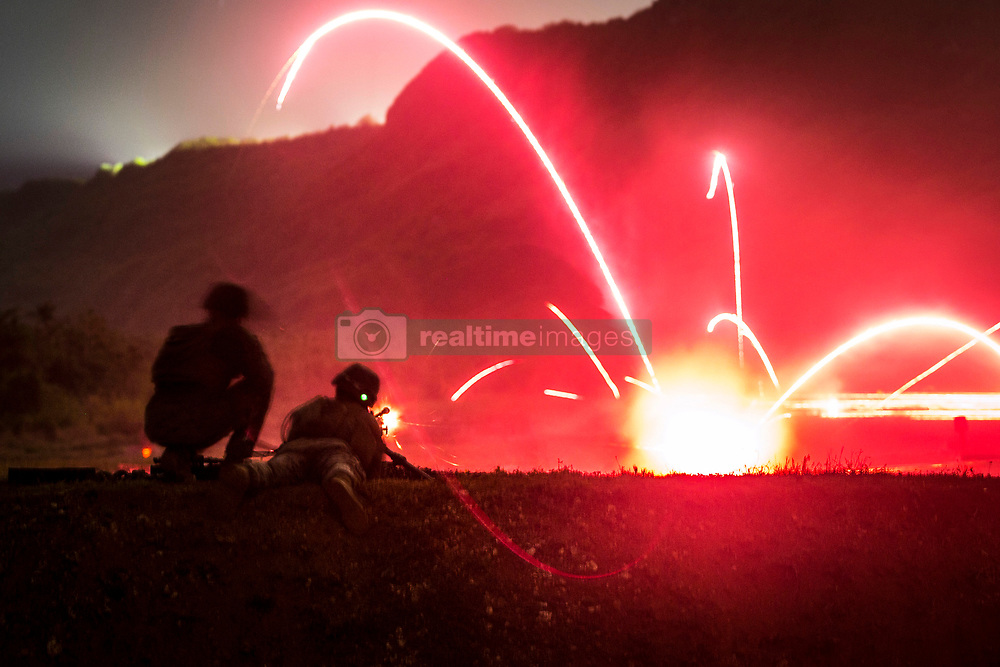 """Lance Cpl. Tyler Marshall, a rifleman with Alpha Company, Battalion Landing Team, 1st Battalion, 4th Marines, the """"China Marines,"""" fires an M240G medium machine gun during low-light live-fire machine gun training at Anderson Air Force Base, Guam, March 11, 2019. Marshall, a native of Greenfield, Illinois, graduated from Greenfield High School in May 2017 before enlisting the following month. Alpha Company Marines are the small boat raid specialists for BLT 1/4, the Ground Combat Element for the 31st Marine Expeditionary Unit. The 31st MEU, the Marine Corps' only continuously forward-deployed MEU partnering with the U.S. Navy's Amphibious Squadron 11, provides a flexible and lethal force ready to perform a wide range of military operations as the premier crisis response force in the Indo-Pacific region. (Official Marine Corps photo by Lance Cpl. Harrison C. Rakhshani/Released)"""
