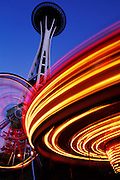 View of the Space Needle and Carnival Rides in Seattle