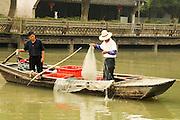 China, Zhejiang Province, Wuzhen Fishing on the waterway