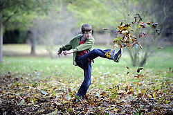© Licensed to London News Pictures. 05/11/2012.A young boy kicking the autumn leaves in the Priory Gardens in Orpington on a sunny day today (05/11/2012) in the southeast..Photo credit : Grant Falvey/LNP
