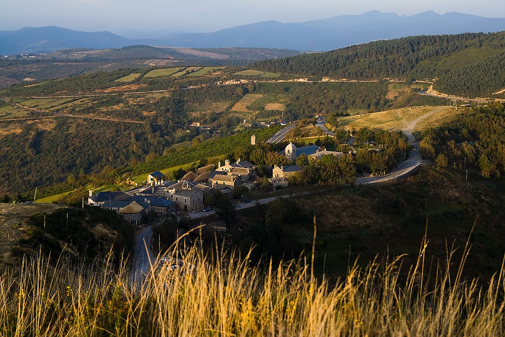 The village of O Cebreiro, surrounded by fields, forests and hills in the countryside of Galicia, Spain along the Camino de Santiago pilgrimage.