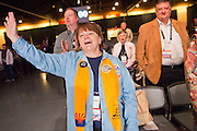 "27 FEBRUARY 2011 - PHOENIX, AZ: Members of the Tea Party Patriots sing ""The Battle Hymn of the Republic"" during a prayer meeting at the Tea Party Patriots American Policy Summit in Phoenix Sunday, the last day of the conference. About 2,000 people were expected to attend the event, which organizers said was meant to unite Tea Party groups across the country. Speakers included former Minnesota Governor Tim Pawlenty, Texas Congressman Ron Paul, former Clinton advisor Dick Morris and conservative blogger Andrew Brietbart. The event ended with a presidential straw poll, which was won by Herman Cain, a newspaper columnist from Atlanta, GA.     Photo by Jack Kurtz"