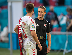 AMSTERDAM, THE NETHERLANDS - Saturday, June 26, 2021: Wales' assistant coach Albert Stuivenberg (R) with Denmark's Joakim Mæhle after the UEFA Euro 2020 Round of 16 match between Wales and Denmark at the Amsterdam Arena. Denmark won 4-0. (Photo by David Rawcliffe/Propaganda)