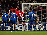 Fotball<br /> Foto: BPI/Digitalsport<br /> NORWAY ONLY<br /> <br /> 24/11/2004 PSV Eindhoven v Arsenal<br /> UEFA Champions League, Philips Stadion, Eindhoven<br /> <br /> Despite the heavy defensive presence Andre Ooijer rises to give PSV the lead