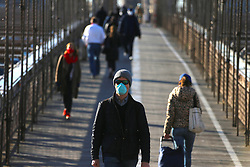 People with face mask on the Brooklyn Bridge during the Covid-19 pandemic in New York City, NY, USA on April 22, 2020. The Big Apple neared a painful milestone Wednesday as the death toll from the coronavirus outbreak that has ravaged the five boroughs approached 15,000. The pandemic has claimed the lives of 14,996 New Yorkers, with new 569 fatalities reported in the most recent 24-hour period, according to data from the city's Department of Health. Photo by Charles Guerin/ABACAPRESS.COM