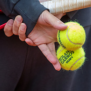 PARIS, FRANCE May 26.  Nicolas Massu, coach of Dominic Thiem of Austria holding official match balls for Roland Garros 2021 during practice on Court Suzanne Lenglen in preparation for the 2021 French Open Tennis Tournament at Roland Garros on May 2pm 6th 2021 in Paris, France. (Photo by Tim Clayton/Corbis via Getty Images)