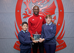 NEWPORT, WALES - Sunday, May 26, 2019: Patrick Vieira presents the D.V. Morgan trophy for the School of the Year award during day three of the Football Association of Wales National Coaches Conference 2019 at Dragon Park. (Pic by David Rawcliffe/Propaganda)