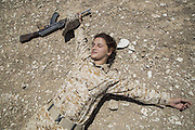 Sulaymaniyah, Iraq - <br /> <br /> Female Fighters of The Peshmerga<br /> As ISIS has swept across northern Iraq, they have become known for their atrocities towards women. However, there's a group of women that aren't preparing to flee ISIS but instead are preparing to meet them with their AK-47s. The 2nd Peshmerga, are a battalion of Kurdish fighters 'Äì and they just happen to be an all-female soldiers. They're front line troops, some of whom have been fighting for years, and they are eager to face ISIS. Dressed in army fatigues and armed with rifles, they are ready to lay down their lives to protect the Kurdish homeland against the threat of ISIS. They carry out training exercises and look no different from other Kurdish soldiers - except for a hint of makeup on some faces and long hair escaping from their caps. The 2nd Battalion consists of 550 mothers, sisters and daughters and was formed in 1996. Over the past month, they have moved into disputed areas abandoned by Iraqi security forces during the Isis advance. They have also recently seized control of oil production facilities at Bai Hassan and Kirkuk - the female Peshmerga will now be part of a mission to secure the city and its surrounding oil fields.<br /> <br /> SHARMIN OMAR, 24, of the 2nd Battalion, plays dead during a military exercise. She is 4 months pregnant and the mother of a 5-year-old girl, and vows not to take any leave before her term. <br /> ©Excluisvepix Media