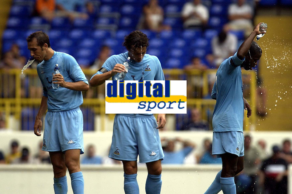 Copyright Sportsbeat Images. 0208 8768611<br />Picture: Henry Browne<br />Date: 10/08/2003<br />Tottenham Hotspur v Sporting Clube de Portugal  <br />Pre season friendly<br />Spurs players try to cool down in the first half