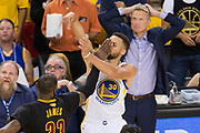 Golden State Warriors guard Stephen Curry (30) is hit in the face by Cleveland Cavaliers forward LeBron James (23) during a jump shot attempt during Game 2 of the NBA Finals at Oracle Arena in Oakland, Calif., on June 4, 2017. (Stan Olszewski/Special to S.F. Examiner)