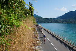 The peloton speed along Lake Annecy at La Course by Le Tour de France 2018, a 112.5 km road race from Annecy to Le Grand Bornand, France on July 17, 2018. Photo by Sean Robinson/velofocus.com