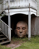 Large Artistic Head under a Porch  McClellanville, South Carolina photo by catherine brown