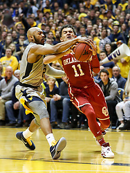 Jan 6, 2018; Morgantown, WV, USA; West Virginia Mountaineers guard Jevon Carter (2) guards Oklahoma Sooners guard Trae Young (11) during the first half at WVU Coliseum. Mandatory Credit: Ben Queen-USA TODAY Sports
