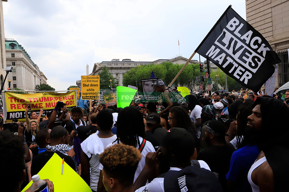 Curtis Aiken waves a Black Lives Matter flag with an image of Heather Heyer in the background during a march in Washington, D.C. on Sunday, Aug. 12, 2018 ahead of a white nationalist rally to take place near the White House. The rally was planned on the anniversary of the Unite the Right rally, organized by the same people, in Charlottesville, Va. where Heyer was killed. Photo by Darryl Smith/TNS/ABACAPRESS.COM