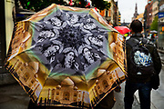 A rainy day with an Indian decorated umbrella on 20th September 2019, in central Oslo, Norway. Norways immigrant population makes up for 16.8% of the countrys total population.