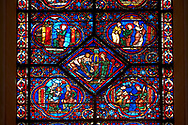 Medieval stained glass Window of the Gothic Cathedral of Chartres, France - dedicated to the Life and Miracles of St Nicholas.  Bottom left panel - The young Nicholas refuses his mother's milk, bottom right panel - Nicholas studying in school . Centre diamon panel - Nicholas gives a poor man the money for his daughters' dowries. Top left -  Guided by God, Nicholas goes to the church early one morning, top right - A cleric asks Nicholas his name, then bids him to enter the church . A UNESCO World Heritage Site. .<br /> <br /> Visit our MEDIEVAL ART PHOTO COLLECTIONS for more   photos  to download or buy as prints https://funkystock.photoshelter.com/gallery-collection/Medieval-Middle-Ages-Art-Artefacts-Antiquities-Pictures-Images-of/C0000YpKXiAHnG2k
