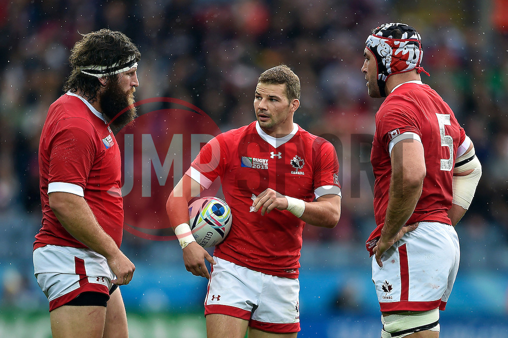 Gordon McRorie of Canada speaks to team-mates Hubert Buydens and Jamie Cudmore - Mandatory byline: Patrick Khachfe/JMP - 07966 386802 - 06/10/2015 - RUGBY UNION - Leicester City Stadium - Leicester, England - Canada v Romania - Rugby World Cup 2015 Pool D.