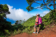 Hiker on the Pihea Trail overlooking the Kalalau Valley, Kokee State Park, Kauai, Hawaii USA