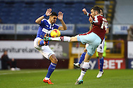 Kevin Bru of Ipswich Town (l) and David Jones of Burnley challenge for the ball. Skybet football league Championship match, Burnley v Ipswich Town at Turf Moor in Burnley, Lancs on Saturday 2nd January 2016.<br /> pic by Chris Stading, Andrew Orchard sports photography.
