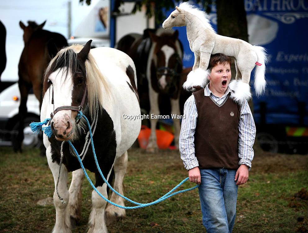 Its been a long day..... a tired young John O'Donoghue with his horses at Ballinasloe Horse Fair. Photographs by Eamon Ward