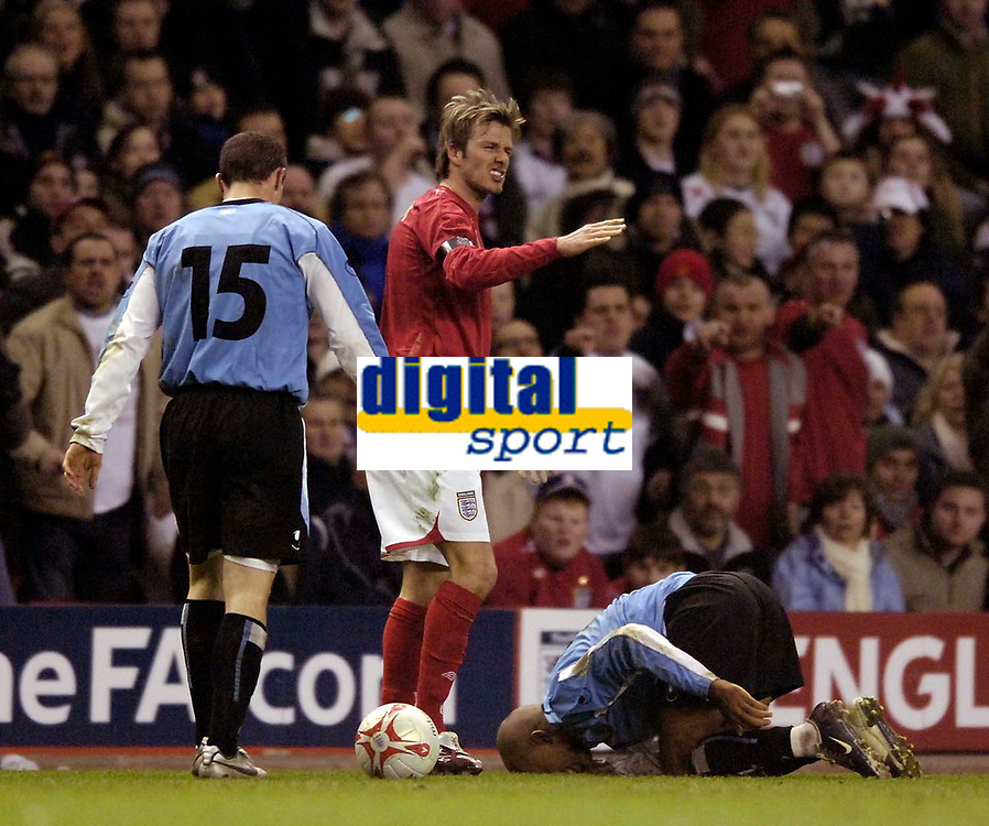 Photo: Jed Wee.<br /> England v Uruguay. International Friendly. 01/03/2006.<br /> <br /> England captain David Beckham protests his innocence prior to being shown the yellow card.