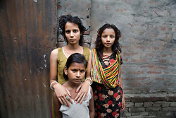 Sex worker sisters Shetu, 17, left, Nodi 14, right, and their cousin Sume, 8, whose mother is also a sex worker, are seen at brothel in Tangail, Bangladesh.<br /> Shetu encountered violence from men throughout her adolescent life. Born into poverty, her first marriage was when she was 12 years old and has a 3-year-old son from the marriage. As her husband did not want a child when she got pregnant, he started physically abusing her. After she delivered a baby, she left her husband and begged on the street. At that time, she was sold to a brothel with a false job offer.