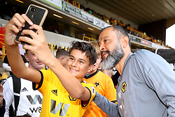 Wolverhampton Wanderers manager Nuno Espirito Santo (right) stops for a picture with a young fan before the Premier League match at Molineux, Wolverhampton.
