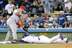 May 11, 2018 - Los Angeles, CA, U.S. - LOS ANGELES, CA - MAY 11: Los Angeles Dodgers First base Cody Bellinger (35) beats the throw to Cincinnati Reds Third base Eugenio Suarez (7) with a triple in the game between the Cincinnati Reds and the Los Angeles Dodgers on May 11, 2018 at Dodger Stadium in Los Angeles, CA.. (Photo by Peter Joneleit/Icon Sportswire) (Credit Image: © Peter Joneleit/Icon SMI via ZUMA Press)