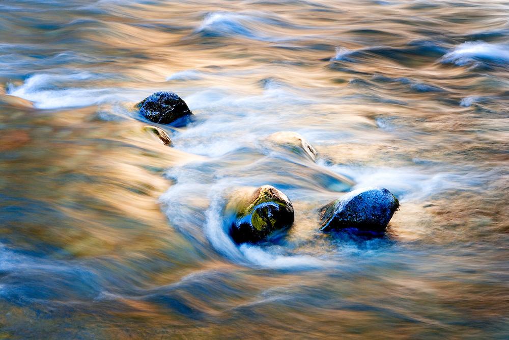 autumn colors reflecting in small cascades in Clackamus River, Oregon