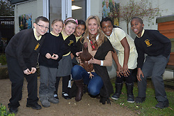 Image ©Licensed to i-Images Picture Agency. 18/12/2014. London, United Kingdom. <br /> <br /> Penny Lancaster visits Charlton Manor Primary School where the Mayors Fund initiative 'Penny for London' is raising money to fund breakfasts for school children.<br /> <br /> Penny Lancaster visits the school's chickens during breakfast club with students at Charlton Manor Primary School<br /> <br /> Picture by Ben Stevens / i-Images