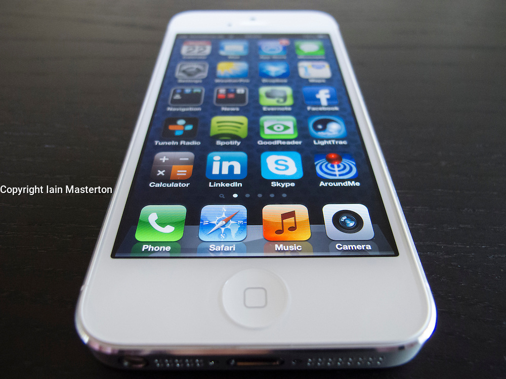 Detail of new iPhone 5 smart phone screen showing many homescreen apps