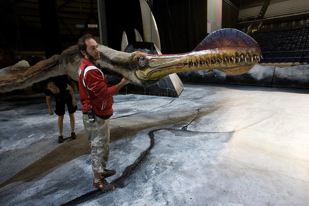 """TACOMA, WA - JULY 13:   Ashley Cole checks the jaw of the Ornthocheirus during a rehearsal check before a performance of """"Walking WIth Dinosaurs"""" on July 13, 2007 at the Tacoma Dome in Tacoma, Washington.  (Photo by David Paul Morris)"""
