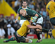 """CJ van der Linde crashes upfield for South Africa late in the match during action from the Tri-Nations Rugby Test Match played between Australia and South Africa at Suncorp Stadium (Brisbane, Australia) on Saturday 24th July 2010<br /> <br /> Conditions of Use : This image is intended for Editorial use only (news or commentary, print or electronic) - Required Images Credit """"Steven Hight - Auraimages/Photosport"""