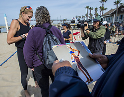 March 26, 2019 - Huntington Beach, California, U.S. - Volleyball fans wait in line on the beach near the Huntington Beach Pier on Tuesday morning, March 26, 2019, in Huntington Beach as Olympic gold medalist Kerri Walsh Jennings, left, signs autographs and takes photographs with fans after a ceremony in which she and her p1440 program donated 25 new volleyball nets next to the Huntington Beach Pier. (Credit Image: © Mark Rightmire/SCNG via ZUMA Wire)