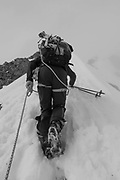 A ski touring group climbing with ropes in an area of Morzine / Portes du Soleil ski area on 22nd March 2017 in France.