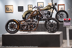 """Jesse Srpan's Raw Iron Choppers 124"""" S&S Evo rigid custom in front of Terence Musto's 1966 Harley-Davidson Shovelhead Chopper with in-the-frame internal suspension in the Old Iron - Young Blood exhibition in the Motorcycles as Art gallery at the Buffalo Chip during the annual Sturgis Black Hills Motorcycle Rally. Sturgis, SD, USA. Wednesday August 9, 2017. Photography ©2017 Michael Lichter."""
