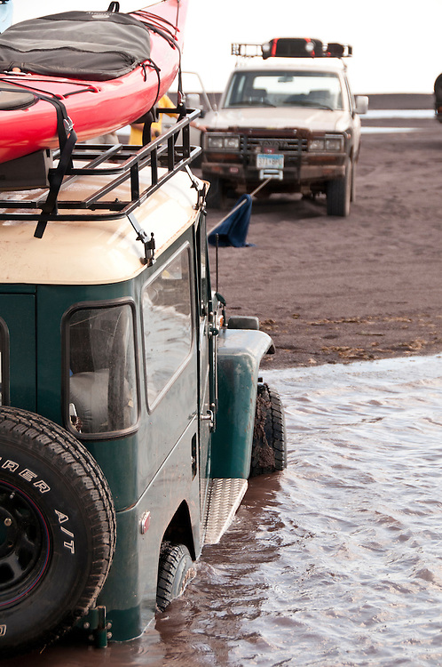 A vehicle is recovered by winch from being stuck in sand and water at a beach in Gay, Michigan during the 2010 U.P. Overland trip in the Upper Peninsula of Michigan.