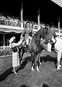 Harvey Smith, leading rider of the winning Great Britain team at the Dublin Horse Show in the RDS, Ballsbridge, Dublin, accepts the Aga Khan team trophy from Mrs Hely Hutchinson.<br /> 7 August 1982
