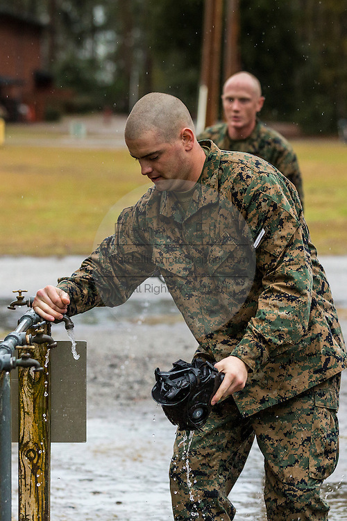 US Marine decontaminate their gas masks after exiting the gas chamber during bootcamp January 13, 2014 in Parris Island, SC.