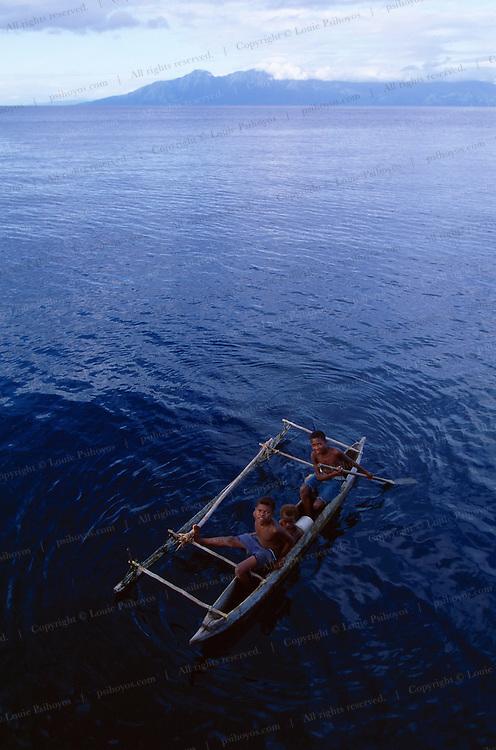 Local boys in a handmade boat.