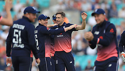 England's Chris Woakes celebrates taking the wicket of West Indies Chris Gayle during the Fourth Royal London One Day International at the Kia Oval, London.