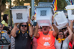 October 1, 2018 - Barcelona, Catalonia, Spain - Several pro-independence protesters are seen showing ballot boxes during the demonstration..Thousands of pro-independence protesters from Catalonia have participated in the anniversary march of the 1-O referendum. (Credit Image: © Paco Freire/SOPA Images via ZUMA Wire)