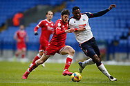 Crawley Town's Ashley Nadesan goes past Bolton Wanderers Ricardo Santos(5) during the EFL Sky Bet League 2 match between Bolton Wanderers and Crawley Town at the University of  Bolton Stadium, Bolton, England on 2 January 2021.