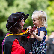 """25.08.2016          <br />  Faculty of Business, Kemmy Business School graduations at the University of Limerick today. <br /> <br /> Sharing at a moment at the conferring were, Phd graduate, Dr. Leonie McMeel Lynch and her 3 year old daughter Beau Milly Lynch, Ballysheedy, Limerick. Picture: Alan Place.<br /> <br /> <br /> As the University of Limerick commences four days of conferring ceremonies which will see 2568 students graduate, including 50 PhD graduates, UL President, Professor Don Barry highlighted the continued demand for UL graduates by employers; """"Traditionally UL's Graduate Employment figures trend well above the national average. Despite the challenging environment, UL's graduate employment rate for 2015 primary degree-holders is now 14% higher than the HEA's most recently-available national average figure which is 58% for 2014"""". The survey of UL's 2015 graduates showed that 92% are either employed or pursuing further study."""" Picture: Alan Place"""