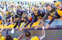 Oct 31, 2020; Morgantown, West Virginia, USA; West Virginia Mountaineers fans celebrate with players after West Virginia defeated the Kansas State Wildcats at Mountaineer Field at Milan Puskar Stadium. Mandatory Credit: Ben Queen-USA TODAY Sports